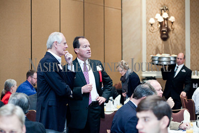 """Dale Polley of CapStar Bank, left, talks with Randy Laszewski of KPMG Thursday during the Nashville Business Journal's """"Banking's New Chessboard"""" panel discussion. The discussion was sponsored by KPMG at Loews Vanderbilt Hotel Nashville. Nathan Morgan 