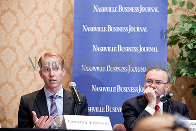 """Timothy Johnson shares a point, left, with Commissioner Jeff Gonzales on his left Thursday during the Nashville Business Journal's """"Banking's New Chessboard"""" panel discussion. The discussion was sponsored by KPMG at Loews Vanderbilt Hotel Nashville. Nathan Morgan 