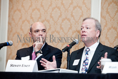 """Jeff Davis listens while Steven Eisen talks Thursday during the Nashville Business Journal's """"Banking's New Chessboard"""" panel discussion. The discussion was sponsored by KPMG at Loews Vanderbilt Hotel Nashville. Nathan Morgan 