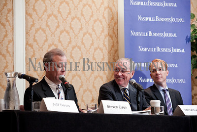 """Ron Samuels, middle, and Timothy Johnson, right, listen to Steven Eisen Thursday during the Nashville Business Journal's """"Banking's New Chessboard"""" panel discussion. The discussion was sponsored by KPMG at Loews Vanderbilt Hotel Nashville. Nathan Morgan 