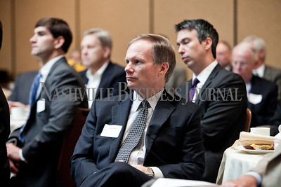 """John W. Titus of Bradley Arant Boult Cummings LLP listens to the panel discussion Thursday during the Nashville Business Journal's """"Banking's New Chessboard"""". The discussion was sponsored by KPMG at Loews Vanderbilt Hotel Nashville. Nathan Morgan 