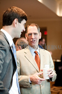 """Wally Conyers of Regions Bank, left, talks with Charlie Sanger of Bradley Arant Thursday during the Nashville Business Journal's """"Banking's New Chessboard"""" panel discussion. The discussion was sponsored by KPMG at Loews Vanderbilt Hotel Nashville. Nathan Morgan 