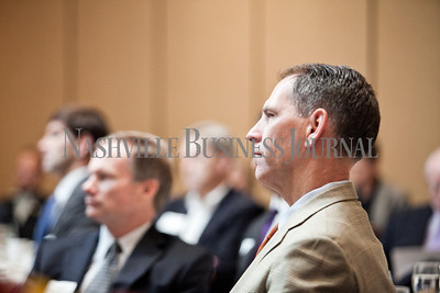 """Charlie Sanger of Bradley Arant Thursday  listens to panelists Thursday during the Nashville Business Journal's """"Banking's New Chessboard"""" panel discussion. The discussion was sponsored by KPMG at Loews Vanderbilt Hotel Nashville. Nathan Morgan 