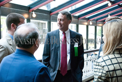 Jim Anderson talks with friends at the Nashville Business Journal's Health Care Heroes celebration luncheon.