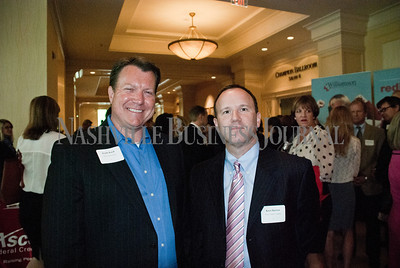 Keith Knell, left,  of The Provident Group with Kurt Barton, of Tractor Supply Company