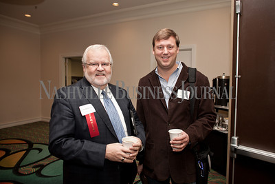 Larry Bridgesmith, left, and Kemp Maxwell pose together Thursday during the Nashville Business Journal's Entrepreneur Exchange presented by Bone McAllister Norton at the Renaissance Nashville Hotel. Nathan Morgan | Nashville Business Journal
