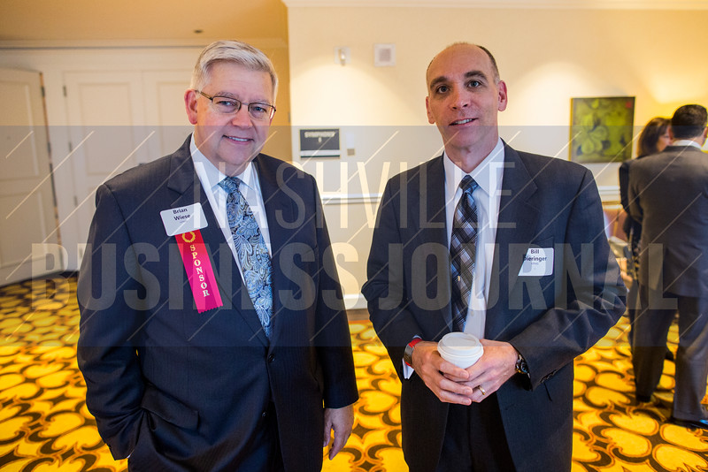 "Brian Wise and Bill Dieringer of KPMG pose for a portrait at The ""New Normal"" breakfast panel at the Loews Vanderbilt Hotel."