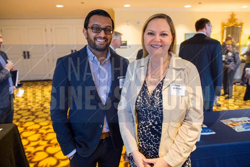 "Uren Patel of KPMG and Jutta Williams of Health First pose for a portrait at The ""New Normal"" breakfast panel at the Loews Vanderbilt Hotel."