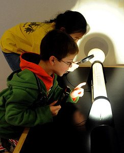 Grant Majors, and Alista Yang, both second-graders at Rocky Mountain Elementary in Westminster, learn why the sky is blue by looking in this tube at the NCAR Visitors Center on Thursday. NCAR (National Center for Atmospheric Research), located in Boulder, will celebrate 50 years of existence this summer. For more photos and a video, go to www.dailycamera.com. Cliff Grassmick/ January 21, 2010.