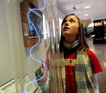 Fallyn Carpenter, 13, of Broomfield, checks out the lightening tube at the NCAR Visitors Center on Thursday. NCAR (National Center for Atmospheric Research), located in Boulder, will celebrate 50 years of existence this summer. For more photos and a video, go to www.dailycamera.com. Cliff Grassmick/ January 21, 2010.