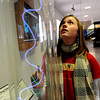 "Fallyn Carpenter, 13, of Broomfield, checks out the lightening tube at the NCAR Visitors Center on Thursday.<br /> NCAR (National Center for Atmospheric Research), located in Boulder, will celebrate 50 years of existence this summer.<br /> For more photos and a video, go to  <a href=""http://www.dailycamera.com"">http://www.dailycamera.com</a>.<br /> Cliff Grassmick/ January 21, 2010."