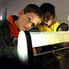 "Grant Majors, and Alista Yang, both second-graders at Rocky Mountain Elementary in Westminster, learn why the sky is blue by looking in this tube at the NCAR Visitors Center on Thursday.<br /> NCAR (National Center for Atmospheric Research), located in Boulder, will celebrate 50 years of existence this summer.<br /> For more photos and a video, go to  <a href=""http://www.dailycamera.com"">http://www.dailycamera.com</a>.<br /> Cliff Grassmick/ January 21, 2010."