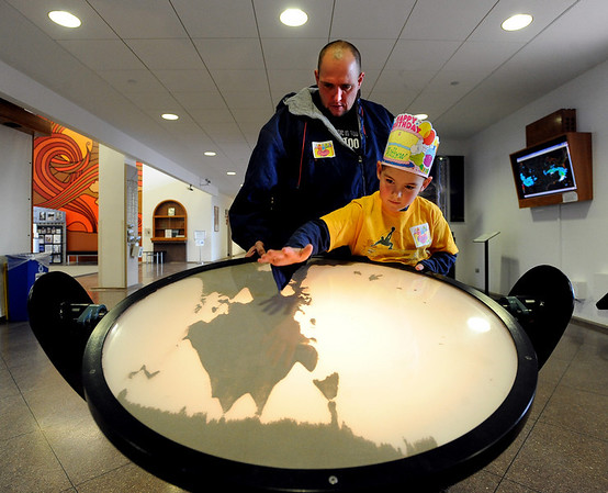 """Joe Ownbey and his son, Matthew, a second-grader from Rocky Mountain Elementary in Westminster, test the behavior of static electricity with the Static Landscape Model at NCAR on a school field trip.<br /> NCAR (National Center for Atmospheric Research), located in Boulder, will celebrate 50 years of existence this summer.<br /> For more photos and a video, go to  <a href=""""http://www.dailycamera.com"""">http://www.dailycamera.com</a>.<br /> Cliff Grassmick/ January 21, 2010."""