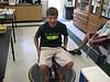 Rio student volunteer, Gavin, rides the hoovercraft!