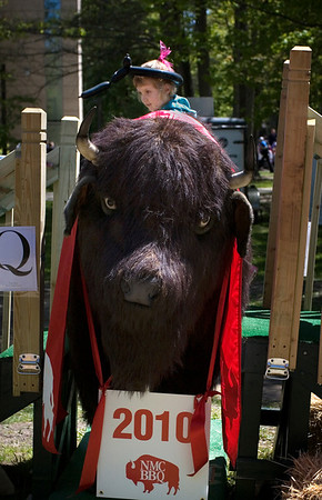 Special to the Record-Eagle/Keith King<br /> Avalon Gillespie, 5, of Traverse City, sits atop an artificial buffalo.