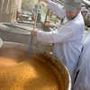 "Special to the Record-Eagle/Keith King Rob Voss, left, and his father, Gil Voss, both of Traverse City, monitor a kettle of beans Sunday during the 55th annual NMC Barbecue. The two have been volunteering at the event since 1960. ""It really has developed,"" Gil, who is the creator of the event's bean recipe, said about the barbecue. ""It's fun to stand back and watch it."" ""I'm kind of known as 'the bean man' because this has been my station for 50 years,"" Gil said."