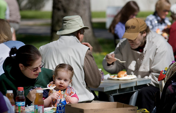 Special to the Record-Eagle/Keith King<br /> Angelique Brown, left, of Lake Ann, feeds her daughter, Abigail Brown, 19 months.