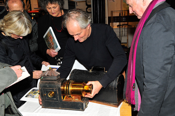 Peter Pearson shows the workings of the Magic Lantern after the show.<br /> Photograph: Margaret Brown<br /> Peter Pearson presented A Magic Lantern Show - Glass Slides of Old Dún Laoghaire.<br /> A Collection of Photographs of the 1880-1920 Period. This presenation took place on Tuesday 11th November 2014 at 7.30pm at The National Maritime Museum of Ireland, Haigh Terract, Dún Laoghaire. For further information contact organiser Eoghan Ganly 087.2377955 or President of the Maritime Institute of Ireland Richard McCormick 087.7556325