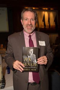 "John T. Shaw holds his book ""JFK in the Senate: Pathway to the Presidency"""