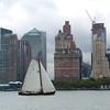 Skûtsje in New York harbor, with southern Manhattan skyline.