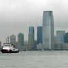 Coastguard boat in New York harbor, with Jersey City skyline.