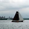 Skûtsje sailing by Ellis Island in New York harbor.