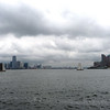 Skûtsjes in New York harbor with Jersey City (left) and Manhattan (right) skyline.