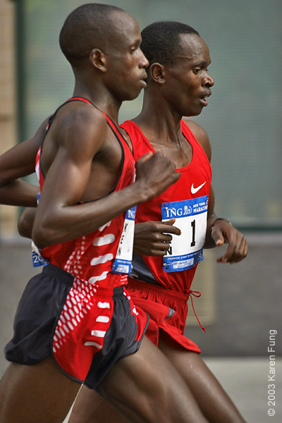 2003:  Martin Lel (left) running side by side with defending champion Rodgers Rop at mile 23.  Lel went on to win the race, and Rop came in second.