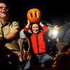 N1031pumpkin.jpg<br /> <br /> October 28, 2007 /  Boulder / Justin McKay, left, Stephanie and Yosie crave pumpkins in preparation of the 9th annual Naked Pumpkin Run in Boulder October 31, 2007. (Sammy Dallal / Daily Camera)
