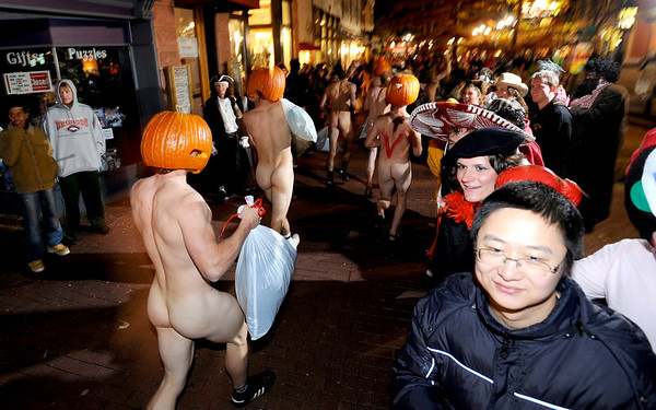 N1101NAKED3.JPG<br /> <br /> Hundreds of people shed their clothes, put a pumpkin on their heads and ran through downtown Boulder for the 9th annual Naked Pumpkin Run in Boulder, Colorado October 31, 2007. CAMERA/Mark Leffingwell