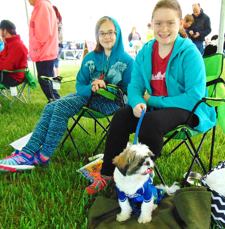Diane Raver | The Herald-Tribune<br /> Maggie Burkhard (left), 11, St. Leon, and Emily Bartley, 10, Sunman, sit with Dewey, who is ready for the costume competition.