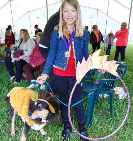Diane Raver | The Herald-Tribune<br /> There were many entries for Best Costume, but Cecilia Barber, 9, Greensburg, and her dog, Daisy, won first place.