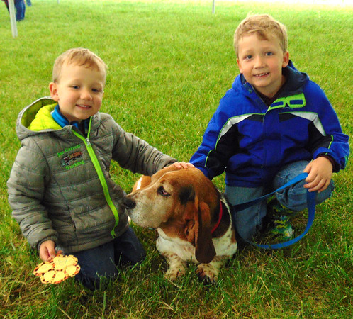 Diane Raver | The Herald-Tribune<br /> Wess Rohrig (left), 4, and Wayd Rohrig, 6, Osgood, are very proud of their dog, Hound.