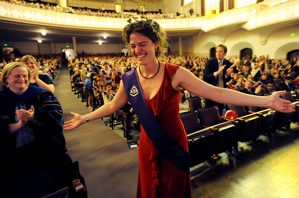 "Jennifer Bohn acknowledges the crowd as she walks up to receive one of the Engaging Graduating Student Award for her work with conservation and recycling at Naropa. She is called the ""Queen of Green.""<br /> Naropa University graduation was held at Macky Auditorium on Saturday, May 8, 2010.<br /> Cliff Grassmick / May 8, 2010"