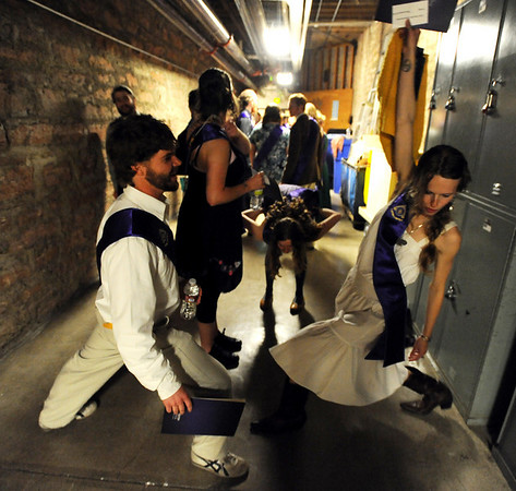 Casey Beauchamp, left and Zoe Zimmerman, were among some of the grds stretching in the basement before the march into the auditorium.<br /> Naropa University graduation was held at Macky Auditorium on Saturday, May 8, 2010.<br /> Cliff Grassmick / May 8, 2010