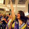 Eden Plastor waves to family and friends before the ceremonies begin.<br /> Naropa University graduation was held at Macky Auditorium on Saturday, May 8, 2010.<br /> Cliff Grassmick / May 8, 2010