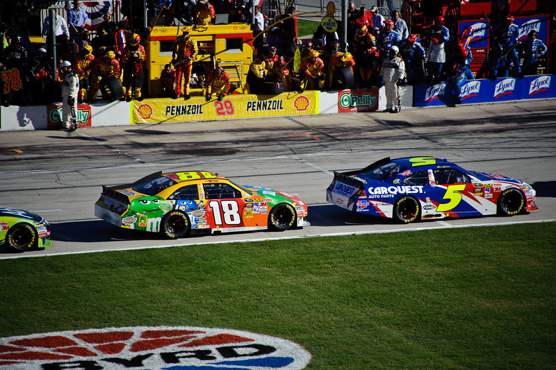 Kyle Busch (18) and Mark Martin (5) on pit road.