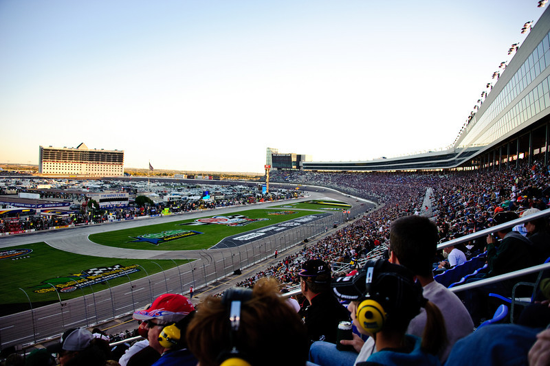 Near-capacity crowd at Texas Motor Speedway. When the sun set, the cars went about 5 miles per hour faster because the track cooled and had more grip on their tires.