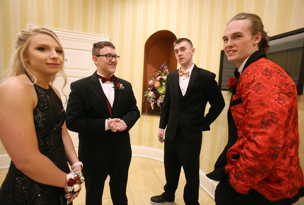 . Nashoba Tech prom at Devens. From left, Ashley Grant of Westford, Charles Myers of Townsend, Jake Driscoll of Ayer and Ben Sheehan of Chelmsford. (SUN/Julia Malakie)