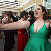 Nashoba Tech prom at Devens. Ashley Hanlon of Townsend holds out a phone. (SUN/Julia Malakie)
