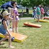Rhea Bujold, owner of The Boulder, and Jenny Karagosian play a game of cornhole at the Nashua River Brewer's Festival was held on Saturday afternoon at Riverfront Park in Fitchburg. SENTINEL & ENTERPRISE / Ashley Green