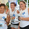 Tip Thirakoun, of Lunenburg, Whitney Ball, of Gardner, and bride-to-be Jessica Gauthier, of Athol, enjoy some samples at the Nashua River Brewer's Festival was held on Saturday afternoon at Riverfront Park in Fitchburg. SENTINEL & ENTERPRISE / Ashley Green