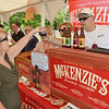 Sherri Barrett, of Fitchburg, has a sample of McKenzie's Hard Cider from John Ellsesear at the Nashua River Brewer's Festival was held on Saturday afternoon at Riverfront Park in Fitchburg. SENTINEL & ENTERPRISE / Ashley Green