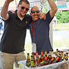 Brian Hartin and Tony Barbaro, from Shocktop, have some fun at the Nashua River Brewer's Festival was held on Saturday afternoon at Riverfront Park in Fitchburg. SENTINEL & ENTERPRISE / Ashley Green