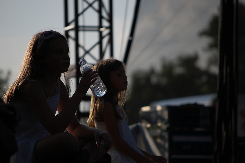 these young ladies were sitting backstage and  knew all the words and were singing along