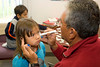 Destiny Sutherland gets a temporary face tattoo from Moose Cree Education Authority Executive Director Norm Wesley.