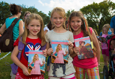 Ella (age 7), Avery (9) and Abbie (9) wait to have their books signed by one of their favorite authors, Kathleen Ernst,