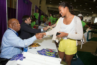 Rep. John Lewis signs books for Bridget and Keiyana Fordham of DC