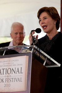 "Former First Lady Laura Bush speaks at the National Book Festival. She was introduced by Librarian of Congress James H. Billington (pictured in background). She read selections from her memoir, ""Spoken From the Heart,"" about her eight years in the White House. In 2001 she joined with the Library of Congress to launch the first National Book Festival in Washington. The 10th annual National Book Festival, organized and sponsored by the Library of Congress, was held on Saturday, Sept. 25, 2010, on the National Mall in Washington, D.C. (Photo by Jeff Malet)."