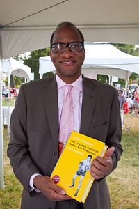 "Wil Haygood signs books at the National Book Festival. Haygood is a prize-winning Washington Post staff writer and an acclaimed biographer. His ""In Black and White: The Life of Sammy Davis Jr."" won the Zora Neale Hurston-Richard Wright Legacy Award, the ASCAP Deems-Taylor Award and was named Nonfiction Book of the Year by the Black Caucus of the American Library Association. ""King of the Cats: The Life and Times of Adam Clayton Powell Jr."" was named a New York Times Notable Book. His family memoir, ""The Haygoods of Columbus,"" received the Great Lakes Book Award. He has been an Alicia Patterson fellow and, for his newspaper work, a Pulitzer Prize finalist. His new book is ""Sweet Thunder: The Life and Times of Sugar Ray Robinson"" (Knopf Doubleday).  The 10th annual National Book Festival, organized and sponsored by the Library of Congress, was held on Saturday, Sept. 25, 2010, on the National Mall in Washington, D.C. (Photo by Jeff Malet)."